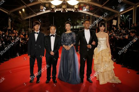 Fom left, actor Lanshan Luo, director Jia Zhangke, actors Tao Zhao, Jiang Wu and Meng Li pose for photographers as they arrive for the screening of film A Touch of Sin at the 66th international film festival, in Cannes, southern France
