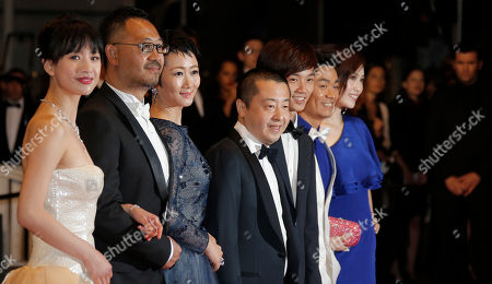 From left, cast Meng Li, Jiang Wu, Tao Zhao, director Jia Zhangke, Lanshan Luo, Baoqiang Wang and Ma Rong arrive for the screening of film A Touch of Sin at the 66th international film festival, in Cannes, southern France