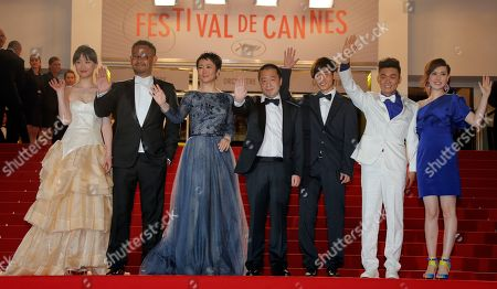 Cast from left, Meng Li, Jiang Wu, Tao Zhao, director Jia Zhangke, Lanshan Luo, Baoqiang Wang and an unidentified guest arrive for the screening of film A Touch of Sin at the 66th international film festival, in Cannes, southern France