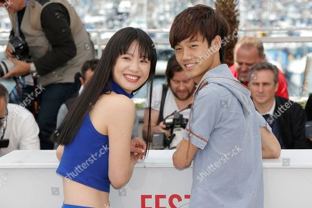 Meng Li, Lanshan Luo Actors Meng Li, left, and Lanshan Luo pose for photographers during a photo call for the film A Touch of Sin at the 66th international film festival, in Cannes, southern France