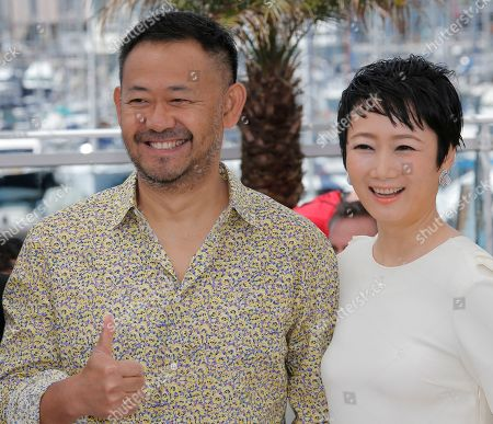 Jiang Wu, Tao Zhao Actors Jiang Wu, left, and Tao Zhao pose for photographers during a photo call for the film A Touch of Sin at the 66th international film festival, in Cannes, southern France
