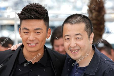 Baoqiang Wang, Jia Zhangke Actor Baoqiang Wang, left, and director Jia Zhangke pose for photographers during a photo call for the film A Touch of Sin at the 66th international film festival, in Cannes, southern France