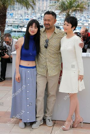 Jiang Wu, Tao Zhao, Meng Li From left, actors Meng Li, Jiang Wu, left, and Tao Zhao pose for photographers during a photo call for the film A Touch of Sin at the 66th international film festival, in Cannes, southern France