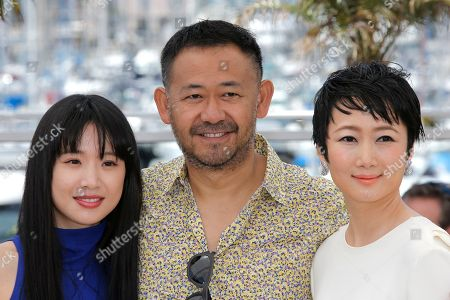 Meng Li, Jiang Wu, Tao Zhao From left, actors Meng Li, Jiang Wu and Tao Zhao pose for photographers during a photo call for the film A Touch of Sin at the 66th international film festival, in Cannes, southern France