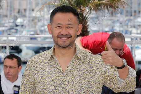 Jiang Wu Actor Jiang Wu poses for photographers during a photo call for the film A Touch of Sin at the 66th international film festival, in Cannes, southern France