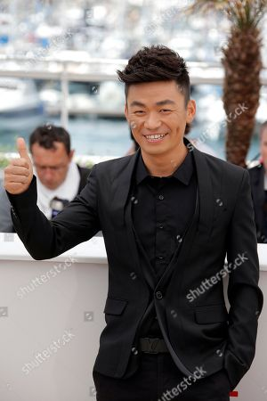 Baoqiang Wang Actor Baoqiang Wang gestures as he poses for photographers during a photo call for the film A Touch of Sin at the 66th international film festival, in Cannes, southern France