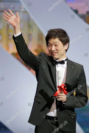 Anthony Chen Anthony Chen waves as he is presented the Camera d'Or award for his film Iloilo during an awards ceremony at the 66th international film festival, in Cannes, southern France