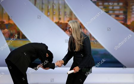 Anthony Chen Director Anthony Chen, left, is presented the Camera d'Or award for Ilo Ilo by director Jane Campion during an awards ceremony at the 66th international film festival, in Cannes, southern France