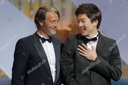 Anthony Chen, Mads Mikkelsen Director Anthony Chen, right, is presented by actor Mads Mikkelsen the Camera d'Or award by for his film Iloilo during an awards ceremony at the 66th international film festival, in Cannes, southern France