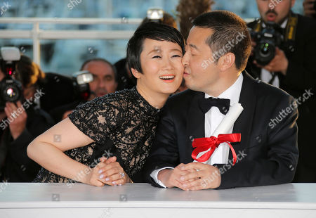 Jia Zhangke, Tao Zhao Director Jia Zhangke, right, poses with the Best Screenplay award for the film A Touch of Sin alongside actress Tao Zhao during a photo call after an awards ceremony at the 66th international film festival, in Cannes, southern France