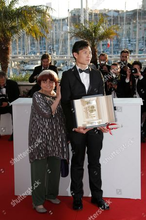 Anthony Chen, Agnes Varda Director Anthony Chen, right, poses with the Camera d'Or award for his film Ilo Ilo, with Camera d'Or award jury president Agnes Varda, left, during a photo call after an awards ceremony at the 66th international film festival, in Cannes, southern France, . during a photo call for the XXX award of the 66th international film festival, in Cannes, southern France, Sunday, May 26, 2013
