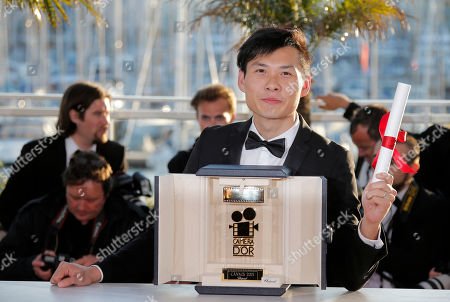 Moon Byoung-Gon Director Anthony Chen poses with the Camera d'Or award for his film Ilo Ilo during a photo call after an awards ceremony at the 66th international film festival, in Cannes, southern France