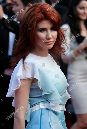 Anna Chapman Russian Anna Chapman, who was deported from the U.S. in July 2010 on charges of espionage, poses for photographers as she arrives for the screening of Behind the Candelabra at the 66th international film festival, in Cannes, southern France