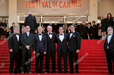 From left at front, writer Greg Jacobs, director Steven Soderbergh, actor Michael Douglas, producer Jerry Weintraub, actor Matt Damon and screenwriter Richard Lagravanese pose for photographers as they arrive for the screening of Behind the Candelabra at the 66th international film festival, in Cannes, southern France