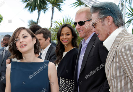 Marion Cotillard, Zoe Saldana, Noah Emmerich, Mark Mahoney From left, actors Marion Cotillard, Zoe Saldana, Noah Emmerich and Mark Mahoney pose for photographers during a photo call for the film Blood Ties at the 66th international film festival, in Cannes, southern France