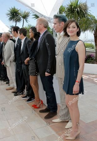 Marion Cotillard, Mark Mahoney Actress Marion Cotillard, right, and actor Mark Mahoney, second from right, pose for photographers with the rest of the cast during a photo call for the film Blood Ties at the 66th international film festival, in Cannes, southern France