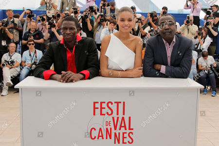Actors Souleymane Deme, left, and Anais Monory, centre, pose for photographers with director Mahamat-Saleh Haroun during a photo call for the film Grigris at the 66th international film festival, in Cannes, southern France