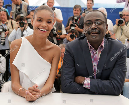 Mahamat-Saleh Haroun, Anais Monory From right, director Mahamat-Saleh Haroun and actress Anais Monory pose during a photo call for the film Grigris at the 66th international film festival, in Cannes, southern France