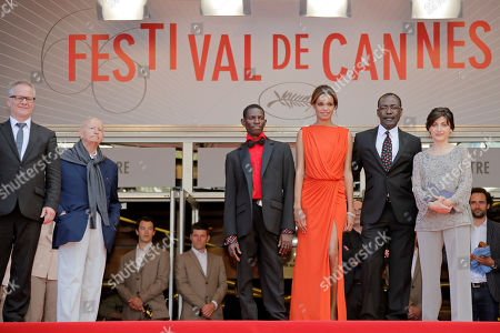 Florence Stern, Mahamat-Saleh Haroun, Souleymane Deme, Anais Monory, Thierry Fremaux, Gilles Jacob From left, Cannes film festival general delegate Thierry Fremaux, President of the Cannes Film Festival Gilles Jacob, actor Souleymane Deme, actress Anais Monory, director Mahamat-Saleh Haroun and producer Florence Stern arrive for the screening of Grigris at the 66th international film festival, in Cannes, southern France