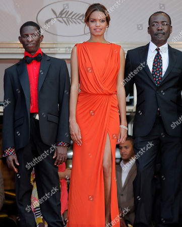 Mahamat-Saleh Haroun, Souleymane Deme, Anais Monory From left, actor Souleymane Deme, actress Anais Monory and director Mahamat-Saleh Haroun arrive for the screening of Grigris at the 66th international film festival, in Cannes, southern France
