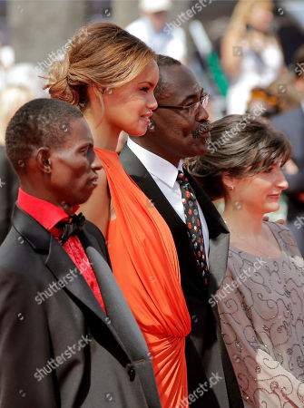 Florence Stern, Mahamat-Saleh Haroun, Souleymane Deme, Anais Monory From left, actor Souleymane Deme, actress Anais Monory, director Mahamat-Saleh Haroun and producer Florence Stern arrive for the screening of Grigris at the 66th international film festival, in Cannes, southern France