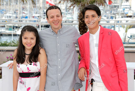 From left, actress Andrea Vergara, director Amat Escalante and actor Armando Espitia pose for photographers aduring a photo call for the film Heli at the 66th international film festival, in Cannes, southern France