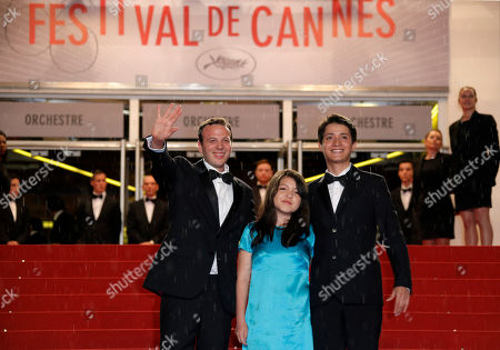 Amat Escalante, Andrea Vergara, Armando Espitia Director Amat Escalante, left, Andrea Vergara, centre, and Armando Espitia pose for photographers as they arrive for the screening of the film Heli at the 66th international film festival, in Cannes, southern France