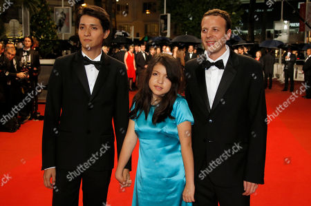 Actors Armando Espitia, left, and Andrea Vergara, centre, pose for photographers with director Amat Escalante as they arrive for the screening of the film Heli at the 66th international film festival, in Cannes, southern France