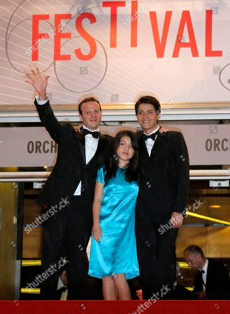 Armando Espitia, Andrea Vergara, Amat Escalante From right, actor Armando Espitia, Andrea Vergara and director Amat Escalante wave from the top of the stairs as they arrive for the screening of the film Heli at the 66th international film festival, in Cannes, southern France