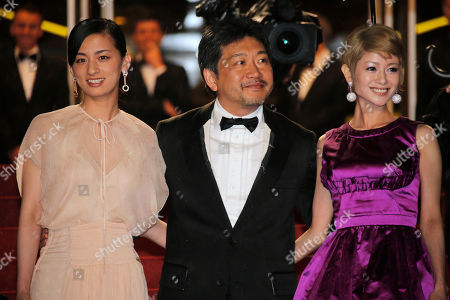 From right, actors Yoko Maki, director Hirokazu Kore-eda, and actor Machiko Ono arrive for the screening of Like Father, Like Son at the 66th international film festival, in Cannes, southern France