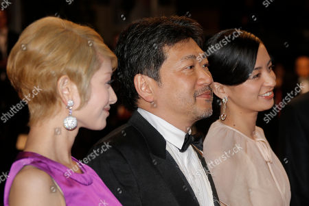 From left, actors Yoko Maki, director Hirokazu Kore-eda, and actor Machiko Ono arrive for the screening of Like Father, Like Son at the 66th international film festival, in Cannes, southern France