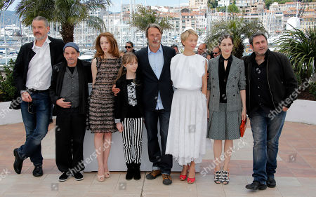 From left, director Arnaud des Pallieres, actors Denis Lavant, Roxane Duran, Melusine Mayance, Mads Mikkelsen, Delphine Chuillot, Amira Casar and Sergi Lopez pose for photographers during a photo call for the film Michael Kohlhaas at the 66th international film festival, in Cannes, southern France