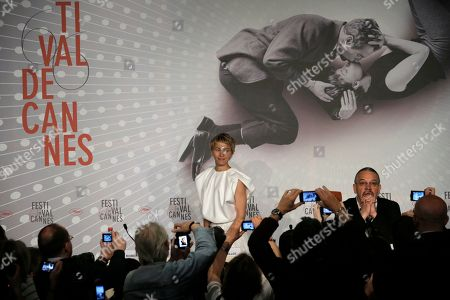 Delphine Chuillot, Arnaud des Pallieres Actress Delphine Chuillot, left, and director Arnaud des Pallieres, right, are photographed by fans and reporters prior to the start of a press conference for Michael Kohlhaas at the 66th international film festival, in Cannes, southern France