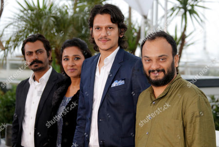 From left, actors Nawazuddin Siddiqui, Tannishtha Chatterjee, Vijay Verma and director Amit Kumar pose for photographers during a photo call for the film Monsoon Shootout at the 66th international film festival, in Cannes, southern France