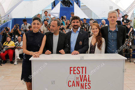 Stock Photo of From right, actor Golshifteh Farahani, director Hiner Saleem, actor Korkmaz Arslan, actor Veronique Wuthrich and producer Marc Bordure pose for photographers during a photo call for the film My Sweet Pepper Land at the 66th international film festival, in Cannes, southern France
