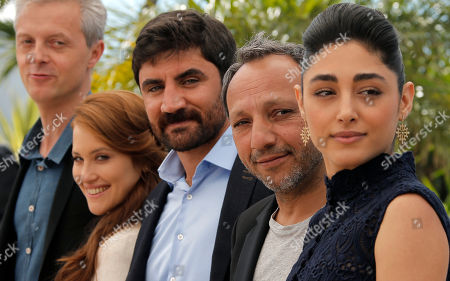 Stock Image of From right, actor Golshifteh Farahani, director Hiner Saleem, actor Korkmaz Arslan, actor Veronique Wuthrich and producer Marc Bordure pose for photographers during a photo call for the film My Sweet Pepper Land at the 66th international film festival, in Cannes, southern France