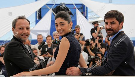 Director Hiner Saleem, left, poses for photographers with actors Golshifteh Farahani, centre, and Korkmaz Arslan during a photo call for the film My Sweet Pepper Land at the 66th international film festival, in Cannes, southern France