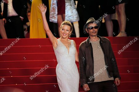 Stock Picture of Kylie Minogue, Leos Carax Singer Kylie Minogue, left, and director Leos Carax arrive for the screening of The Great Beauty at the 66th international film festival, in Cannes, southern France