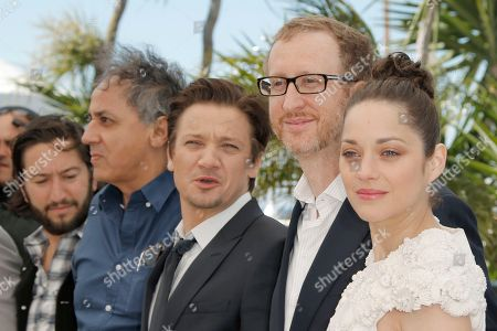 Greg Shapiro, Darius Khondji, Jeremy Renner, James Gray, Marion Cotillard From left, producer Greg Shapiro, director Of photography Darius Khondji, actor Jeremy Renner, director James Gray and actress Marion Cotillard pose for photographers during a photo call for the film The Immigrant at the 66th international film festival, in Cannes, southern France