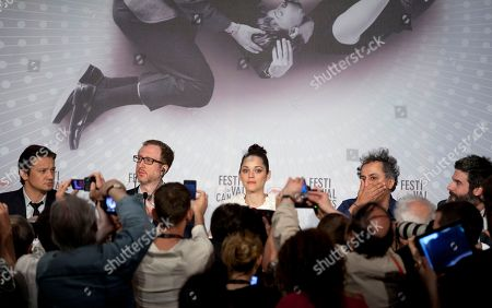 From left, Jeremy Renner, director James Gray, actress Marion Cotillard, director of photography Darius Khondji and producer Anthony Katagas attend a press conference for The Immigrant at the 66th international film festival, in Cannes, southern France