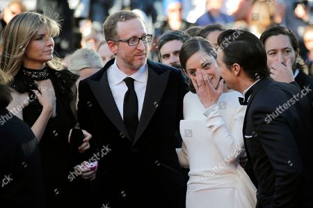 Ali Gray, James Gray, Marion Cotillard, Jeremy Renner, Greg Shapiro From left, Ali Gray, her husband director James Gray, actors Marion Cotillard, Jeremy Renner and producer Greg Shapiro, rear, arrive for the screening of The Immigrant at the 66th international film festival, in Cannes, southern France