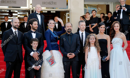 Cast members from left, Ali Mosaffa, Tahar Rahim, Elyes Aguis, Berenice Bejo, director Asghar Farhadi, producer Alexandre Mallet-Guy, Jeanne Jestin, Sabrina Ouazani, and Pauline Burlet wave from the top of the red carpet as they arrive for the screening of the film The Past at the 66th international film festival, in Cannes, southern France