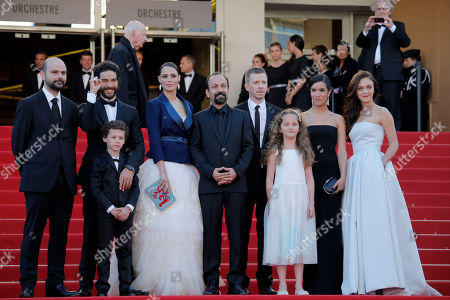 Cast members from left, Ali Mosaffa, Tahar Rahim, Elyes Aguis, Berenice Bejo, director Asghar Farhadi, producer Alexandre Mallet-Guy, Jeanne Jestin, Sabrina Ouazani, and Pauline Burlet stand at the top of the red carpet as they arrive for the screening of the film The Past at the 66th international film festival, in Cannes, southern France