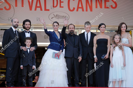 Cast members from left, Ali Mosaffa, Tahar Rahim, Elyes Aguis, Berenice Bejo, director Asghar Farhadi, producer Alexandre Mallet-Guy, Sabrina Ouazani, Jeanne Jestin and Pauline Burlet wave from the top of the red carpet as they arrive for the screening of the film The Past at the 66th international film festival, in Cannes, southern France