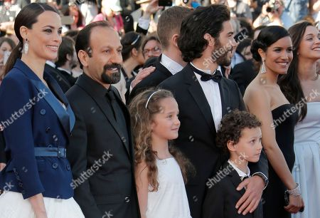 Cast members from left, Berenice Bejo, director Asghar Farhadi, Jeanne Jestin, Tahar Rahim, Elyes Aguis, Sabrina Ouazani, and Pauline Burlet arrive for the screening of the film The Past at the 66th international film festival, in Cannes, southern France