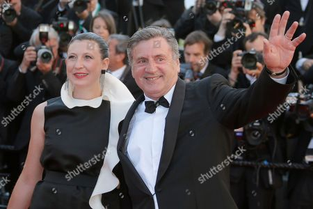 Stock Picture of Daniel Auteuil, Aude Ambroggi Jury member, actor Daniuel Auteuil, right, waves as he arrives with his wife Aude Ambroggi for the screening of the film Venus in Fur at the 66th international film festival, in Cannes, southern France