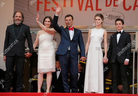 Frederic Pierrot, Geraldine Pailhas, Francois Ozon, Marine Vacth, Fantin Ravat From left, actors Frederic Pierrot, Geraldine Pailhas, director Francois Ozon, actors Marine Vacth and Fantin Ravat pose for photographers as they arrive for the screening of Young & Beautiful at the 66th international film festival, in Cannes, southern France