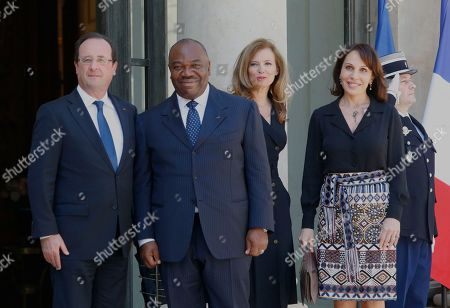 French President Francois Hollande, second from left, and his companion Valerie Trierweiler, third from right, welcome Gabon's President Ali Bongo Ondimba, second from left, and his wife Sylvia, right, prior to a lunch for the Felix Houphouet-Boigny Peace Prize at the Elysee palace, Paris
