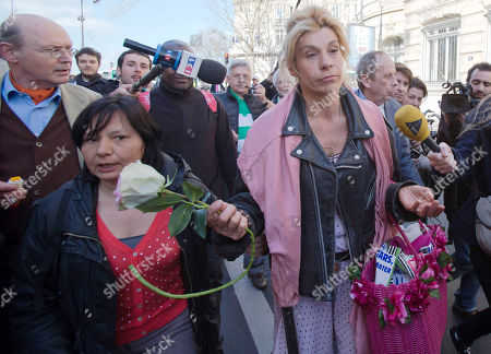 Virginie Tellenne, known as Frigide Barjot, right, leaves the National Assembly after French lawmakers legalized same-sex marriage, in Paris. Lawmakers legalized same-sex marriage after months of bruising debate and street protests that brought hundreds of thousands to Paris. Tuesday's 331-225 vote came in the Socialist majority National Assembly. France's justice minister, Christiane Taubira, said the first weddings could be as soon as June