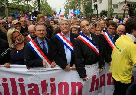 Jean-Francois Cope, Pierre Lellouche French right-wing opposition party, Union for a Popular Movement (UMP) President Jean-Francois Cope, second from left, attends the anti-gay marriage demonstration in Paris, . The law came into force over a week ago but organizers of the march decided to go forward with the long-planned demonstration in a bid to show their continued opposition as well as their frustration with President Francois Hollande, who had made legalizing gay marriage one of his keynote campaign pledges in last year's election. Standing at right is National Assembly member Pierre Lellouche, other are unidentified